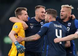 Soccer-Denmark game overshadowed by Eriksen collapse as Finns win 1-0