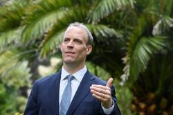 Britain wants to ease tensions with EU over N.Ireland, says Raab
