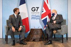EU and UK's 'sausage war' sizzles at G7 as Macron and Johnson spar