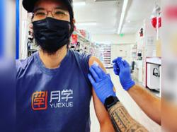 Singer Wang Leehom receives his Covid-19 vaccine in US