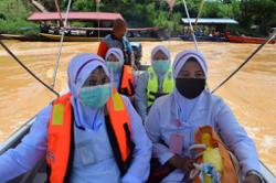 Covid-19: 39-member team brave strong currents to vaccinate villagers in Kelantan