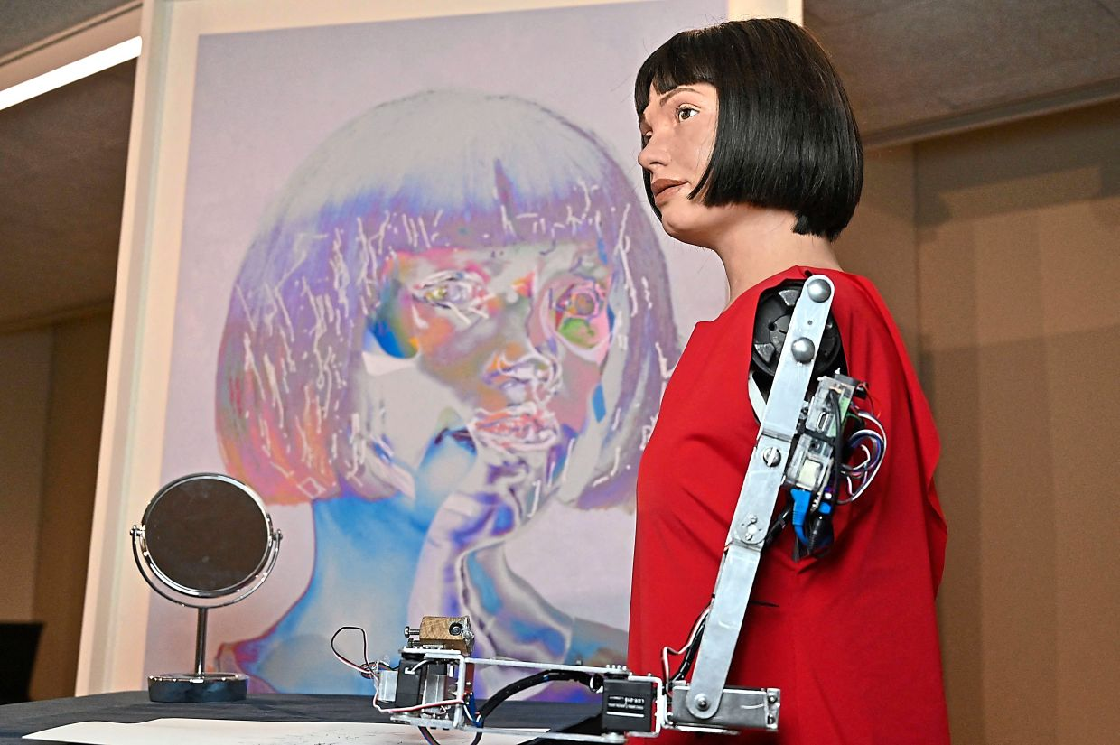 The world's first ultra-realistic AI robot artist, Ai-Da, who can draw, paint and is a performance artist. Photo: AFP