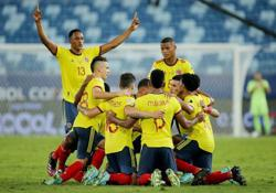 Soccer-Intricate free kick move helps Colombia beat Ecuador