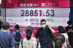 Markets mostly down in holiday-thinned Asia trade, eyes on Fed