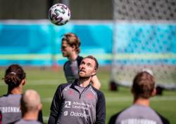 Soccer-Denmark draw strength as team mate Eriksen remains stable