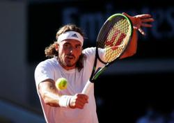 Tennis-Grieving Tsitsipas pulls out of Wimbledon warm-up in Halle