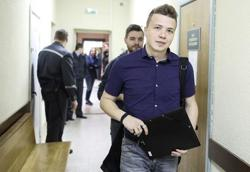 Jailed Belarus journalist attends news conference in Minsk