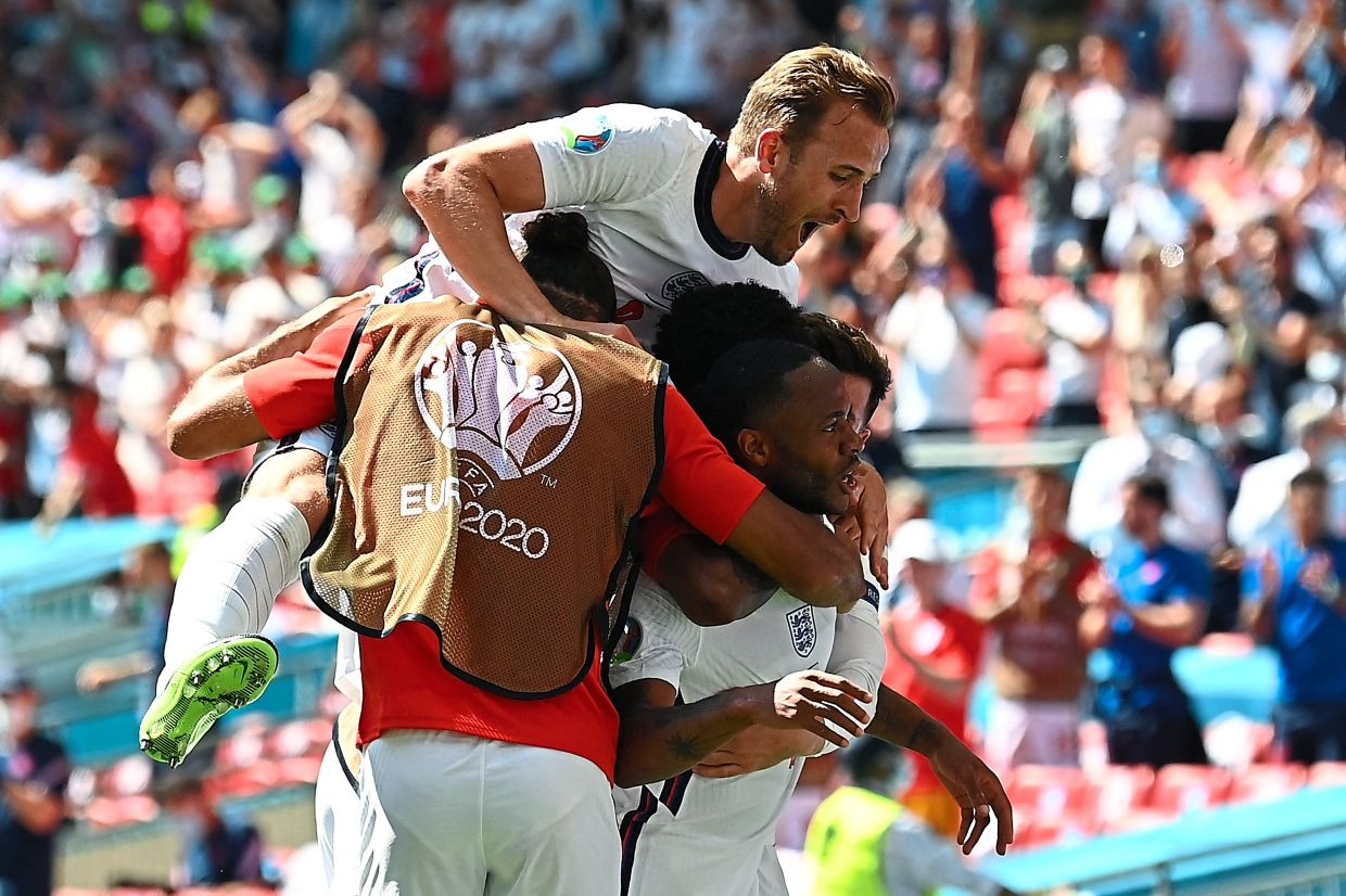 Sterling is hugged by teammates