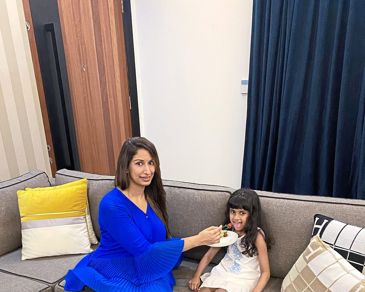 Saritha has been working hard to get four-year-old picky eater Rania to eat a more diverse range of fruits during the lockdown. — SARITHA DEVI KIRUPALANI