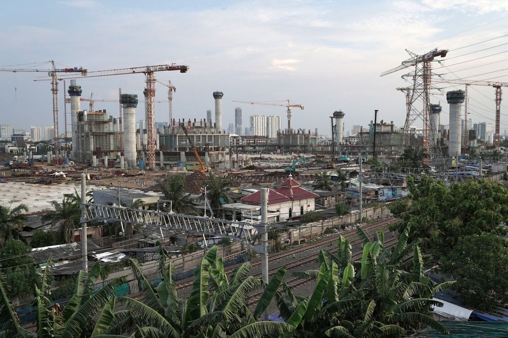 Cranes at a construction site in Jakarta, Indonesia. - Bloomberg