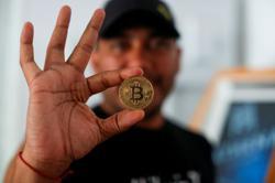 In El Salvador's bitcoin beach town, digital divide slows uptake