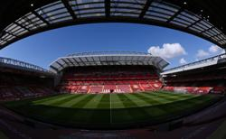 Soccer-Liverpool to expand Anfield to over 61,000 seats, rail seating to be trialled