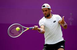 Tennis-Berrettini wins all-Italian opener at Queen's