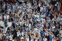 Soccer-Finland fans eye knockout stages after 'unreal' Denmark experience