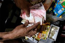 Philippine peso falls most since April on curb extension
