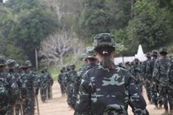 Myanmar militia group halts attacks on troops; Suu Kyi 'confident' in court
