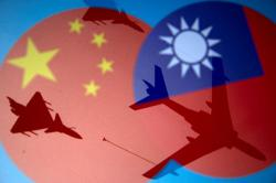 China sends 28 planes near Taiwan in year's largest exercise