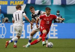 Soccer-Russia back on track in Euros after 1-0 win over Finland