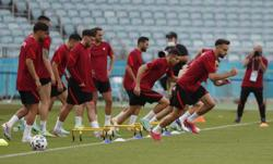Soccer-Wales unchanged, Turkey bring in Ayhan and Under