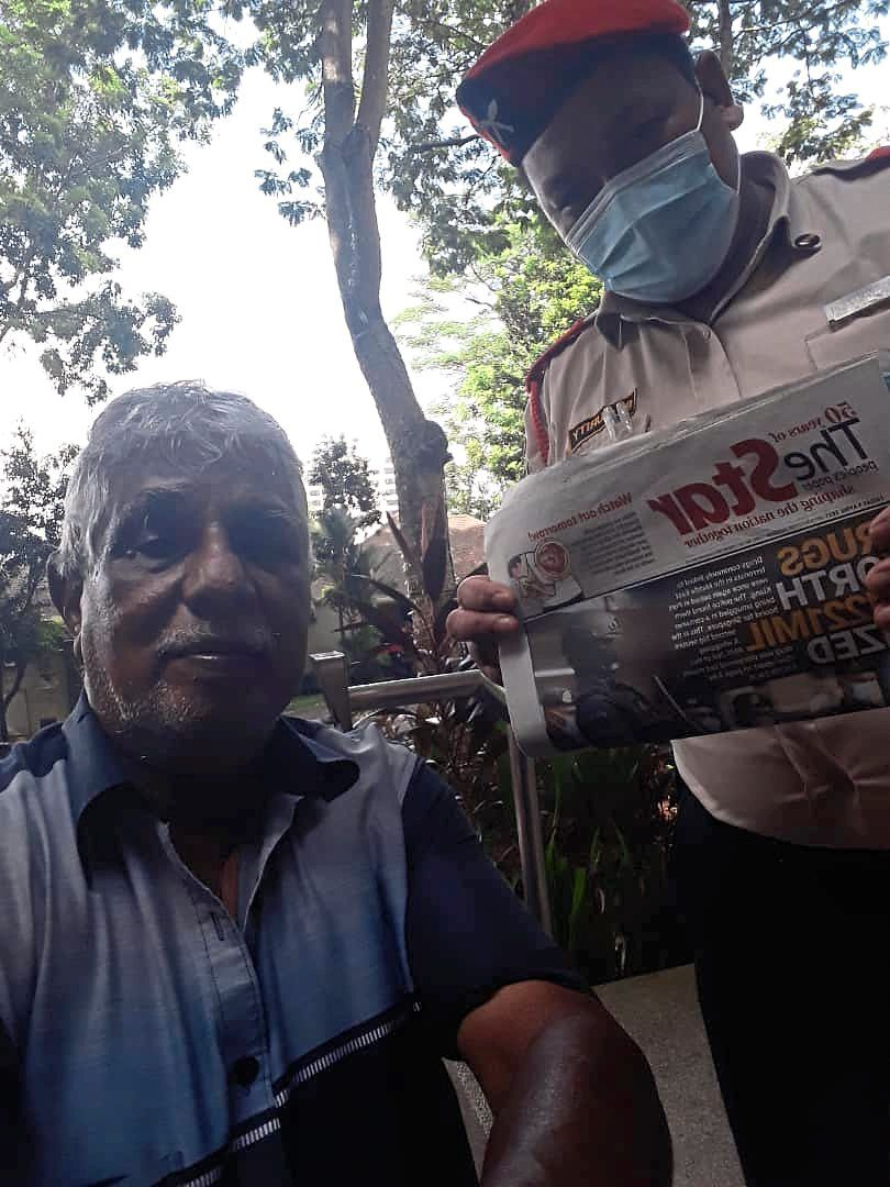 Subramanian (left) distributes newspapers around Bangsar and does not plan to retire just yet