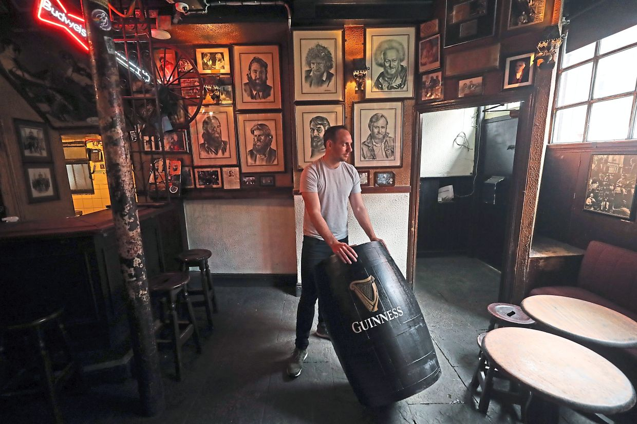Barden preparing for outdoor opening at O'Donoghue's in Dublin ahead of the reopening of pubs in Ireland after lockdown restrictions were eased.