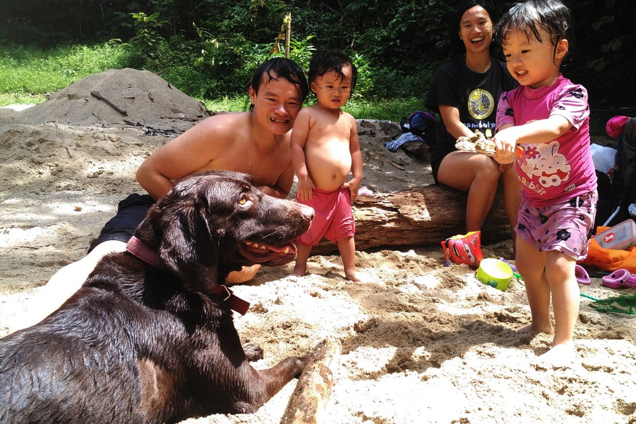 Outdoors in the jungle with Chocolate, their labrador, in 2016. Photo: Linus Chung