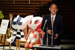 Japan seeks to end Tokyo virus emergency a month before Olympics