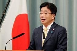 Japan aims to introduce vaccine passports by late July -govt spokesman