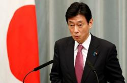 Experts agree to ease emergency curbs in Tokyo but warn of risks -minister