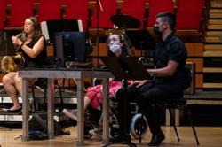 Technology helps disabled student play the harp with her eyes
