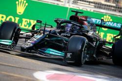 Motor racing-Mercedes modify Hamilton's 'magic' button after Baku blow