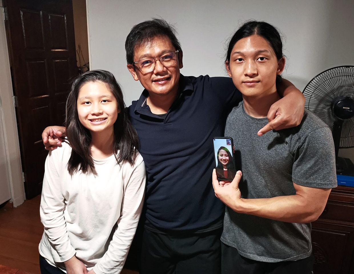 Staying in touch: Video calls are a weekly thing for Sharizan (centre) and (from left) younger daughter Kaylin, son Kayden and elder daughter Kayra (on Zoom from Australia). Photo: Sharizan Borhan