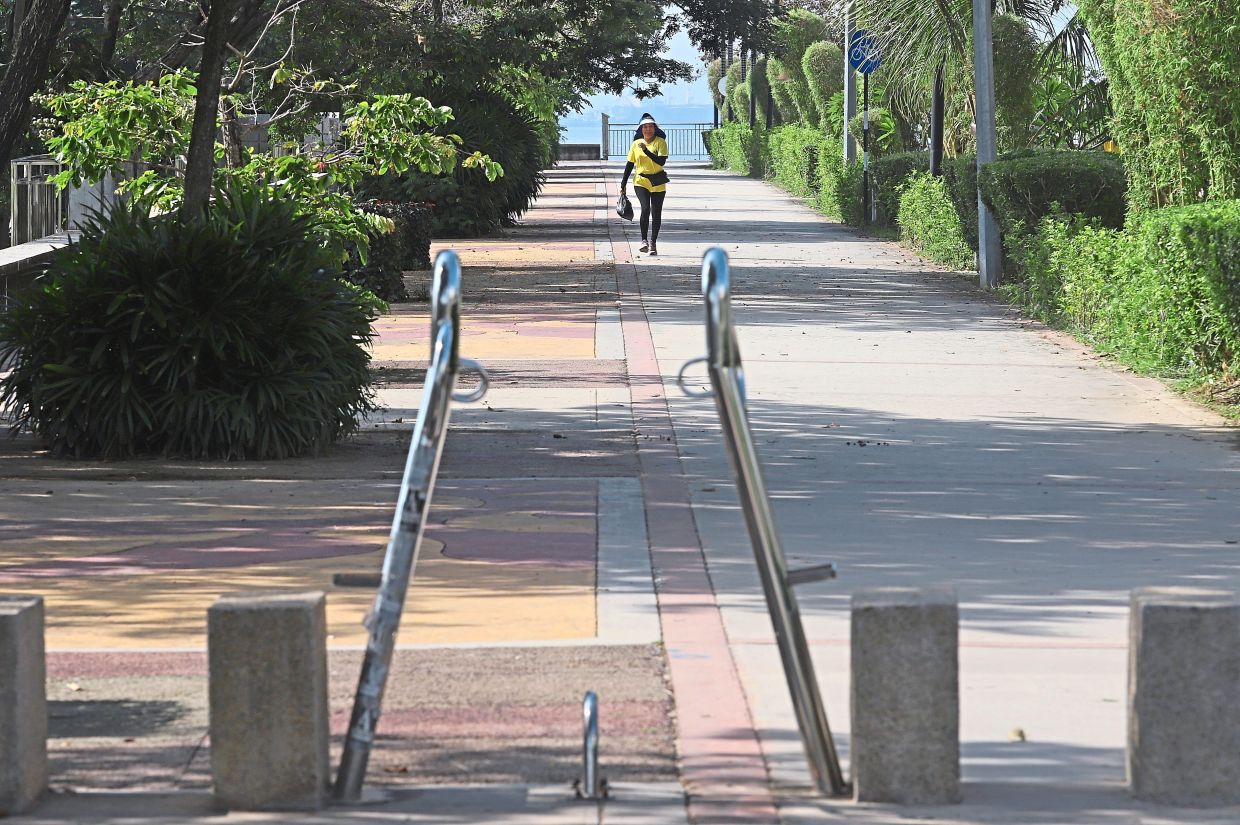 A walker finding plenty of space for herself at Karpal Singh Drive.