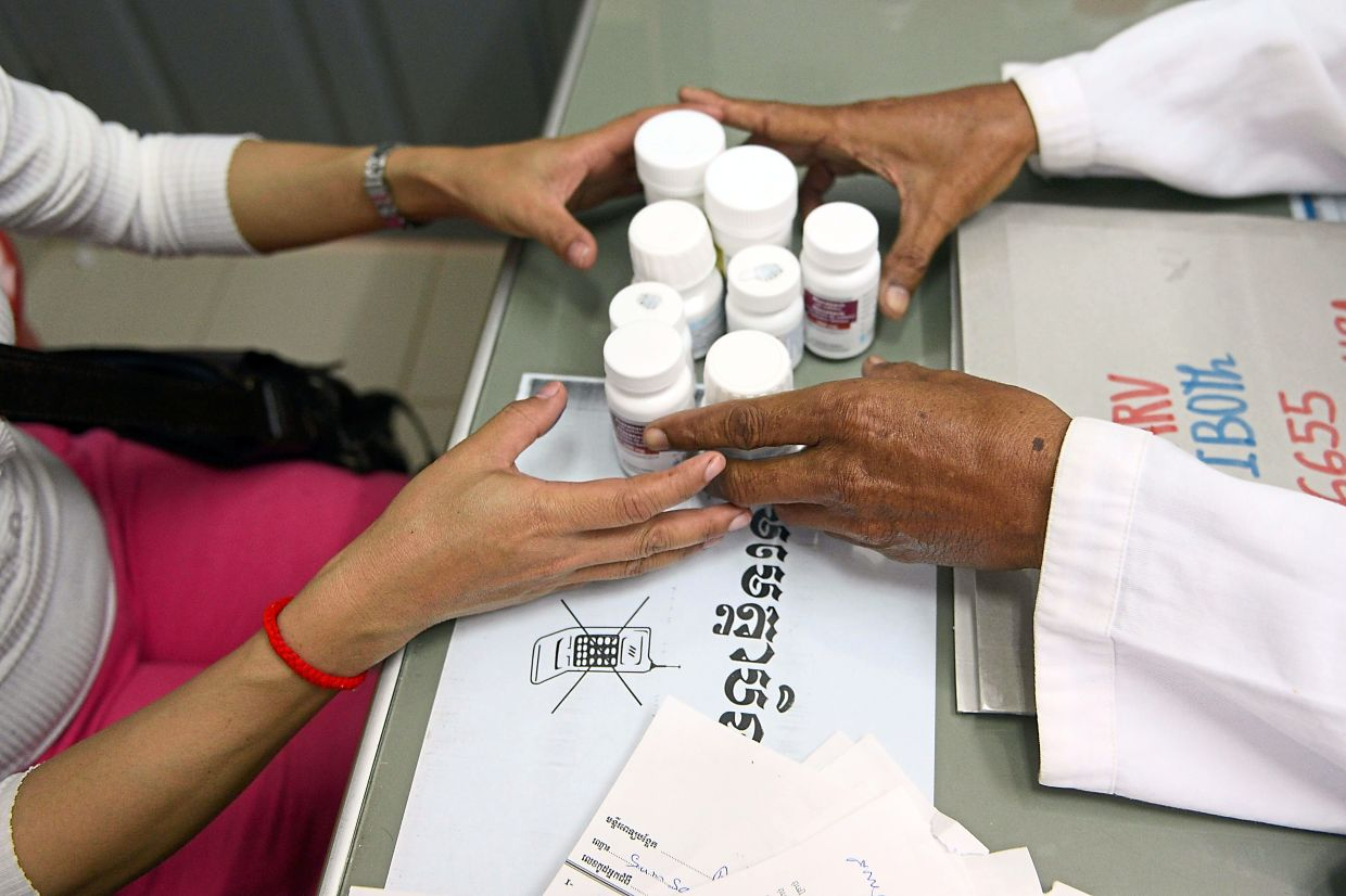 From multiple medicines with many side effects as seen in this filepic, HIV treatments have advanced to the point where some patients only need to take one pill a day. — AFP