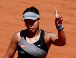 Tennis-Osaka pulls out of Wimbledon but aims for Olympics