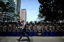 Arrested ex-Philippine mayor killed after grabbing police's firearm