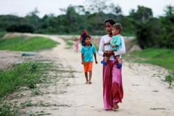 Amid pandemic, number of people forced to flee homes has risen, says U.N.