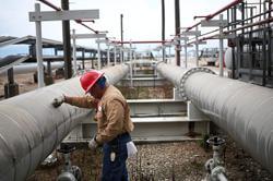 Crude oil extends slump as traders weigh dollar against demand