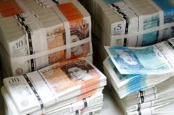 Pound tumbles as virus resurgence clouds hope for UK recovery