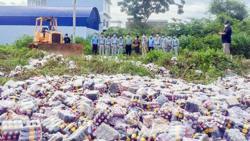 Cambodia: 30, 000 bottles of dong quai wine destroyed after seven killed; major drug bust by cops