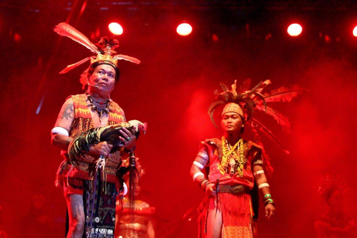 An Iban elder leading the 'miring' ceremony during the opening of the RFWF in 2019.  Photo: The Star/Filepic
