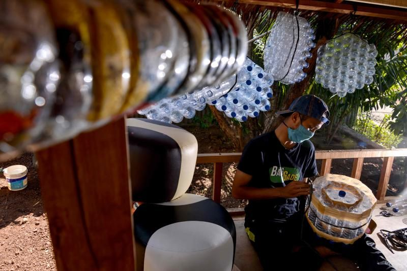 Zainuddin, who is a teacher, makes furniture with recycled plastic bottles at his workshop in Banda Aceh on Saturday, June 19, 2021. - AFP