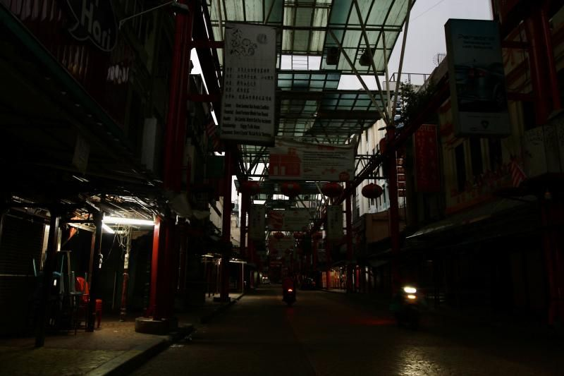 The usually ultra busy Petaling Street in Kuala Lumpur looking deserted due to the Covid-19 Movement Control Order. — LOW LAY PHON/The Star