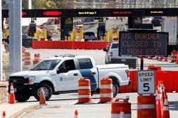 Businesses, U.S. legislators fume as Canada extends travel ban; Trudeau stands firm