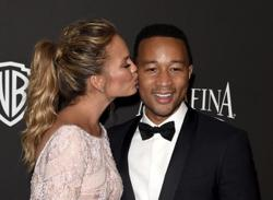 Chrissy Teigen and John Legend claim Michael Costello 'made up' direct messages