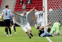 Soccer-Early header secures 1-0 win for Argentina against Uruguay