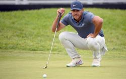 Golf-Feuding Koepka, DeChambeau avoid heavyweight pairing at U.S. Open