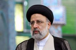 Hardline judge wins landslide in Iran presidential vote amid low turnout
