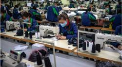 Laos VP calls for compliance with Covid-19 rules in garment factories