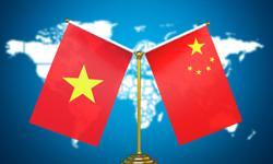 China vows to advance socialist drive, bilateral ties with Vietnam
